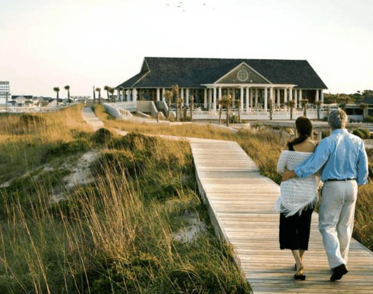 A couple walking towards their house
