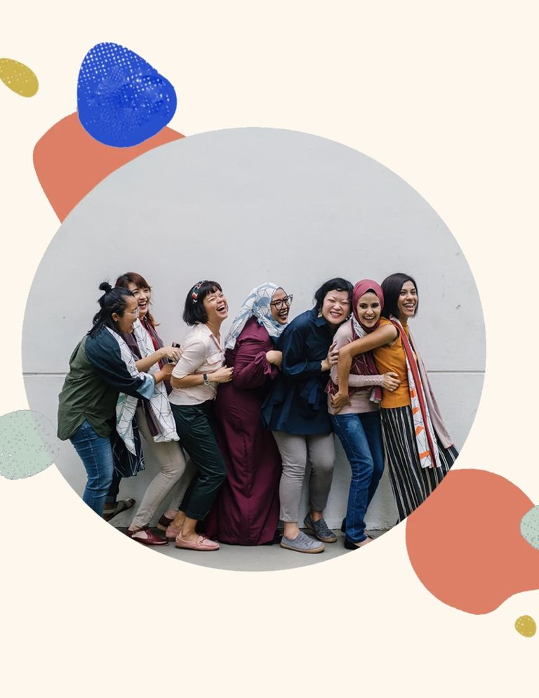 7 women standing together and smiling