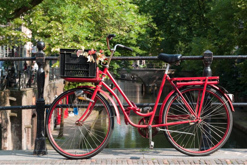 A red bike on a bridge in Utrecht