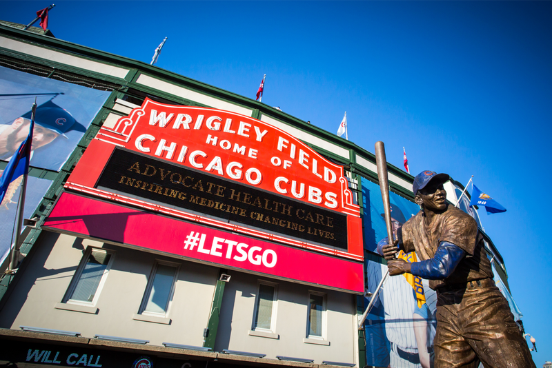 The famous signage on a warm summer's night at Wrigley Field