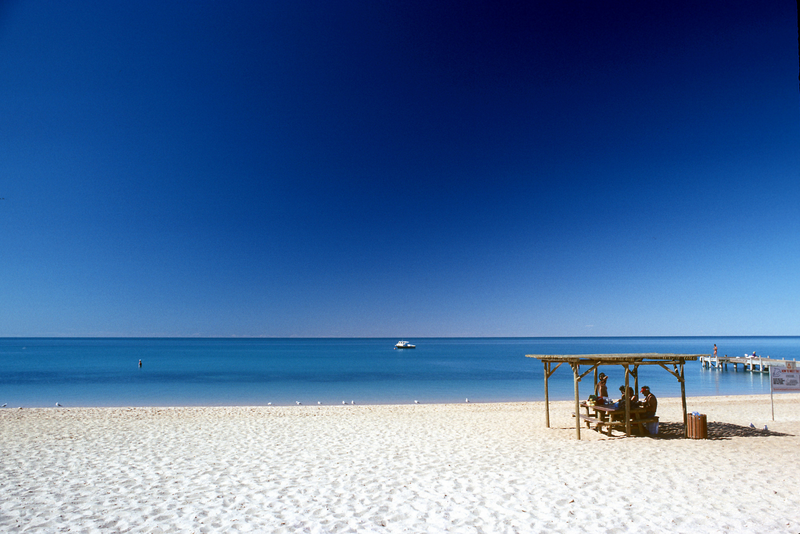 People resting on a cottage at Cottesloe Beach, Perth