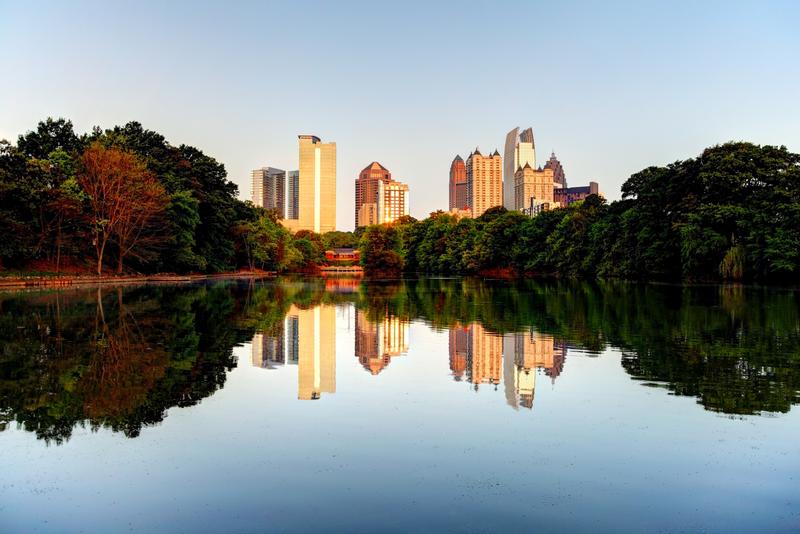 Atlanta skyline reflecting on a small pond in Piedmont Park.