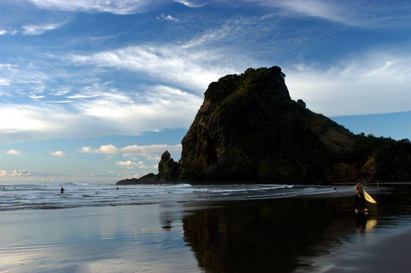 Blue skies and black sand at Piha Beach.