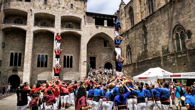Competing Casteller groups making human towers.