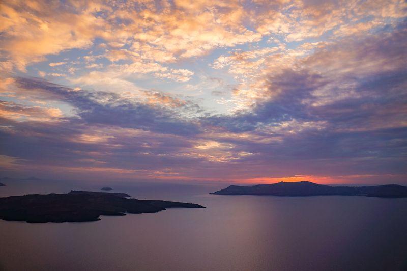 The sun setting over the caldera in Santorini