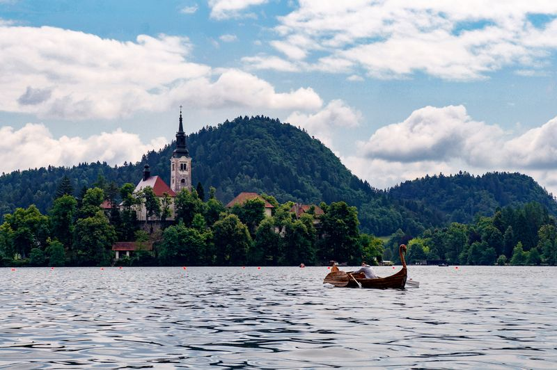 Rowing to the monastery on the island on Lake Bled