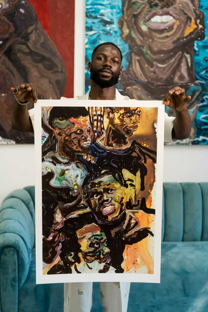 Artist Ludovic Nkoth is holding his print All Aboard