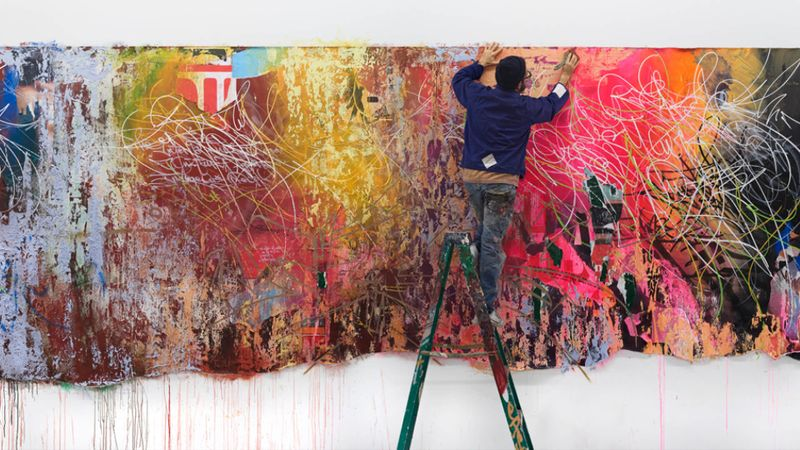Artist named Jose Parla paints a large scale paining