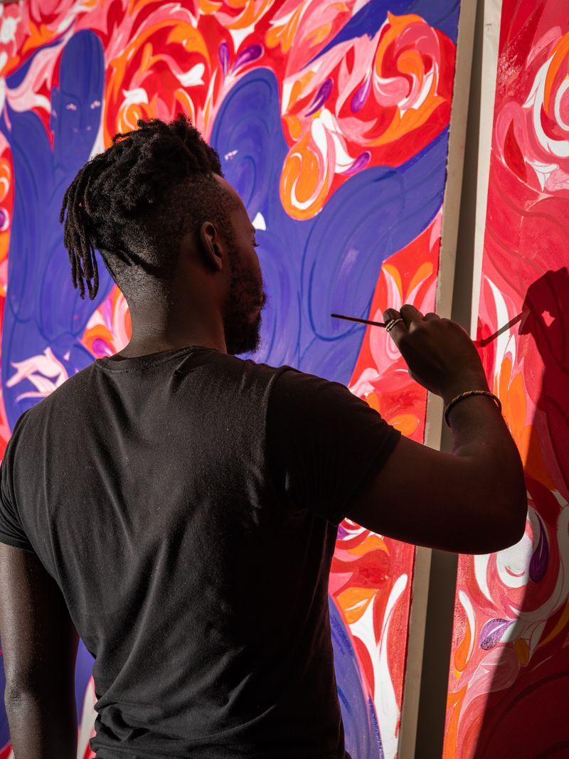 Artist Tunji Adeniyi-Jones hand-finishing his print in the studio