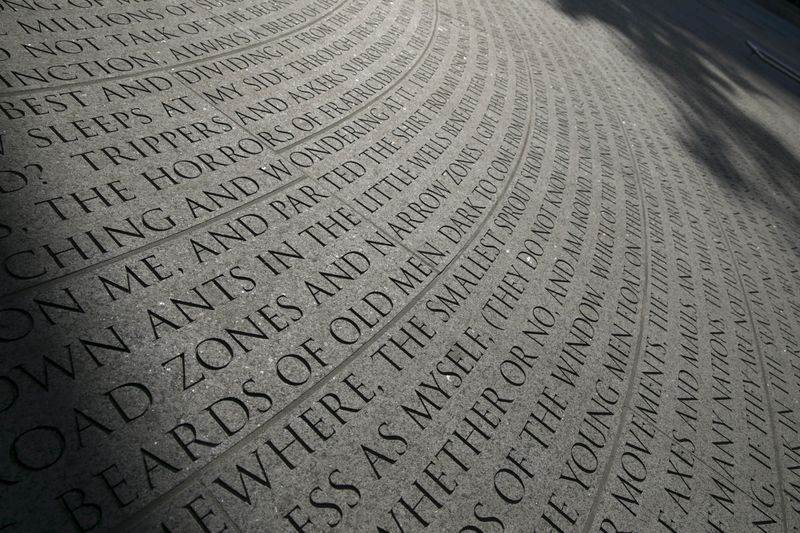 lettering engraved in a stone, NYC Aids Memorial - close up