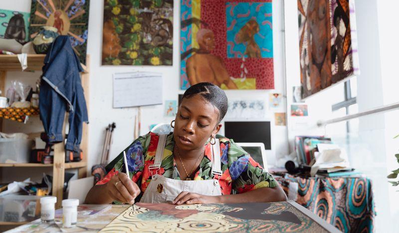Artist Shannon Bono hand-finishing her print