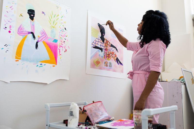 Artist Grace Lynne Haynes hand-finishing her print in the studio