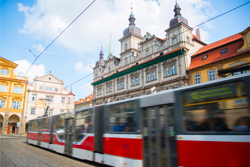 A Prague tram moving in a square of the city centre.