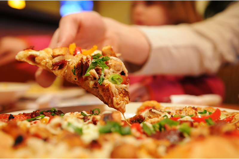 Grabbing a slice of pizza