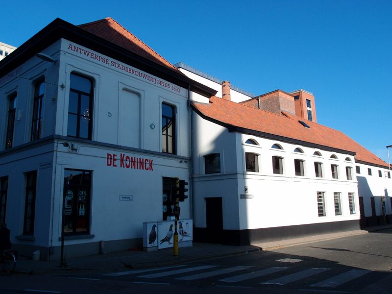 The whitewashed exterior of De Koninck Brewery in Antwerp
