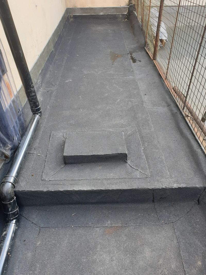 The finished product with raised inspection cover to gain acsess to the pipe work inspection cover.  Our client  the owner of Ilford Plaza was vewry pleased with the neat finish and could clearly see the difference between our predecessors workmanship to our own and was glad the call was to Aldersbrook roofing flat roof experts.