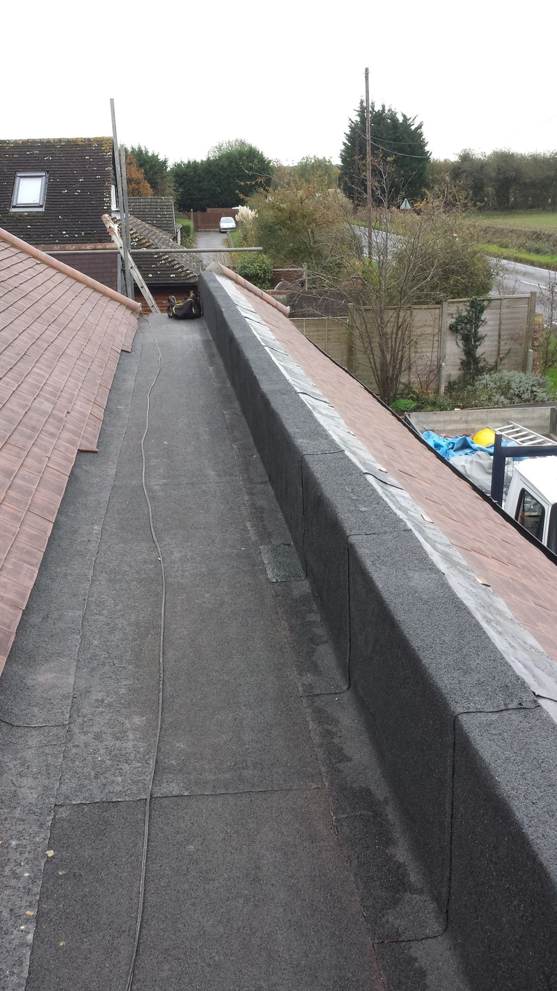 Flat roof and plain tile detailing Epping Essex fitted by Aldersbrook 175mtr tiled roof