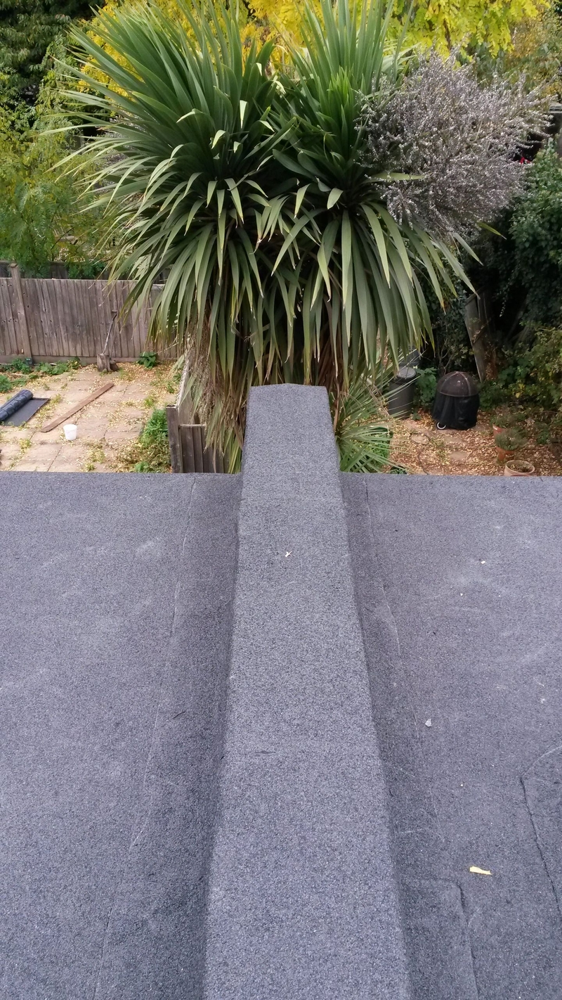 Parapet wall encapsulation detail installed by Aldersbrook in E1