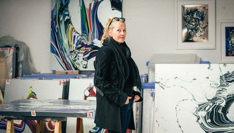 Katrin Fridriks stood in her studio surrounded by multiple paintings