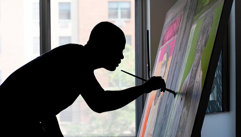 Silhouette of Marcus Brutus adding details to a canvas using a large paintbrush