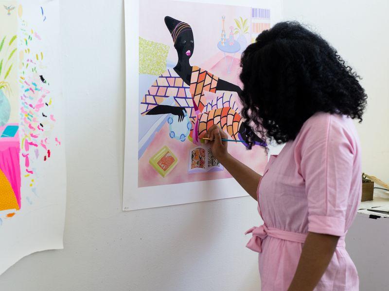 artist Grace Lynne Haynes painting a detail of her print