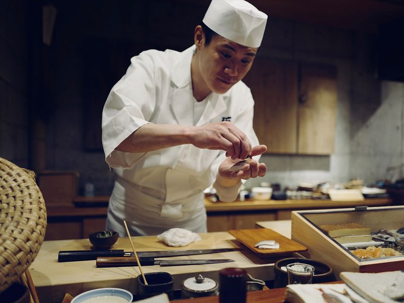 chef preparing sashimi in Japanese restaurant