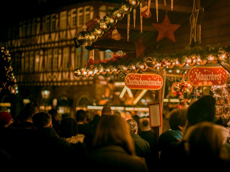 people walking around christmas markets in germany