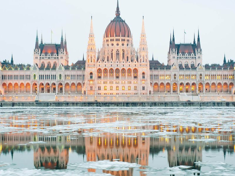 icy water infront of hungarian parliament building in budapest hungary