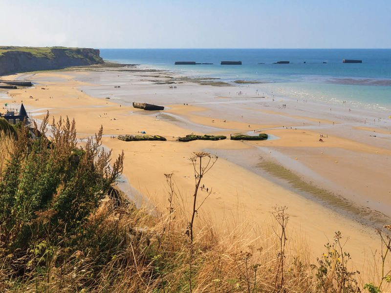 remains of artificial port at normandy landings beach in france