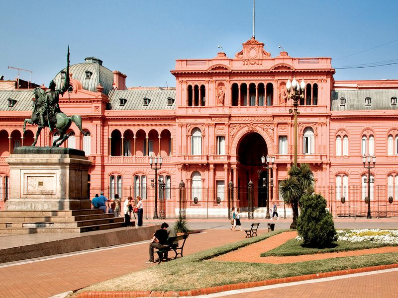 people in front of the casa rosada in buenos aires argentina on sunny day