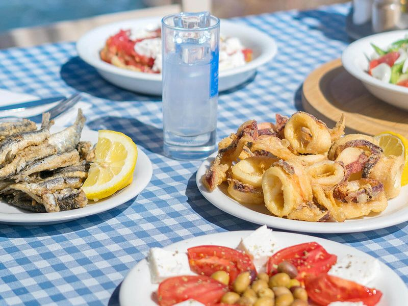 greek food on blue checkered table