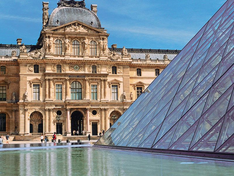 the louvre pyramid in courtyard near the louvre museum