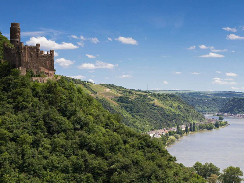 panorama of rhine river valley with castle maus in germany