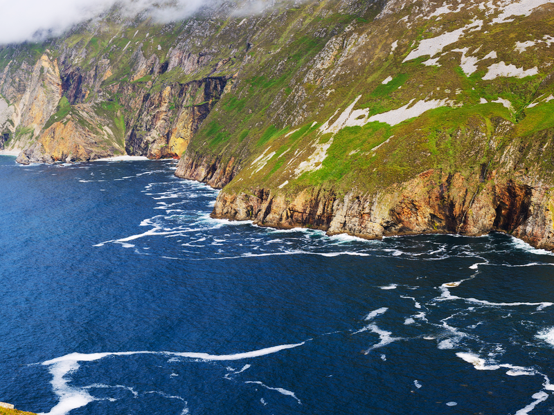 rugged cliffs along the atlantic ocean on the wild atlantic way in ireland