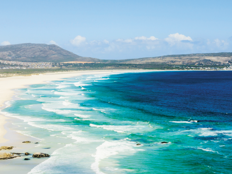 blue ocean waves crashing on the sand along the coast of south africa