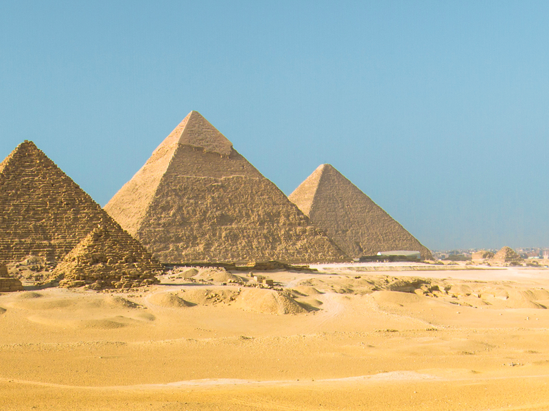 the pyramids of giza in egypt on a sunny day