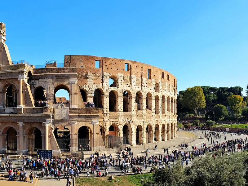 crowds of people surrounding the colosseum in rome italy