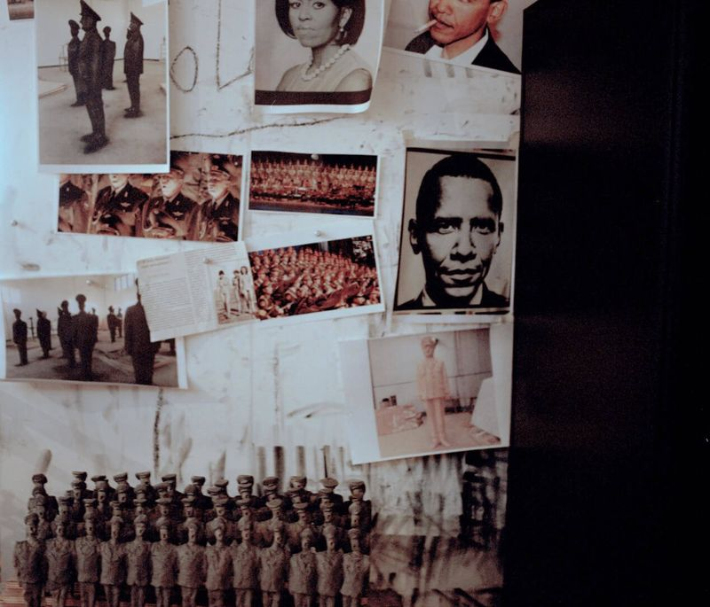 photographs of Barack Obama, his wife and soldiers pinned to a wall