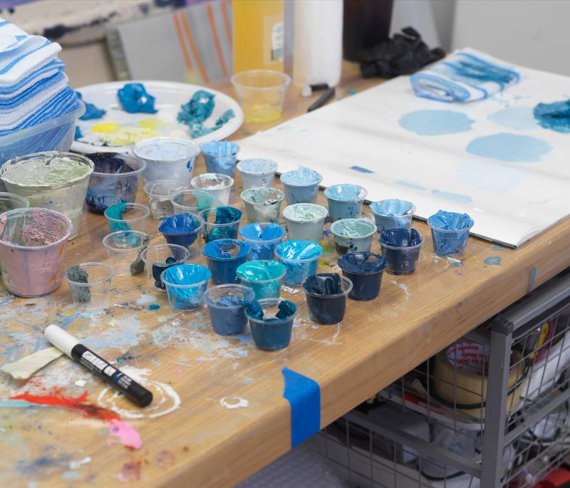 small pots of paints in different shades of blue