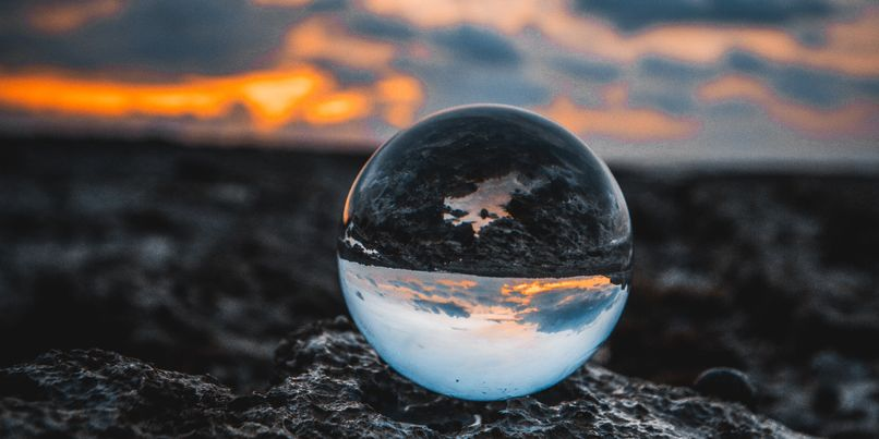 Planet earth reflected in a marble