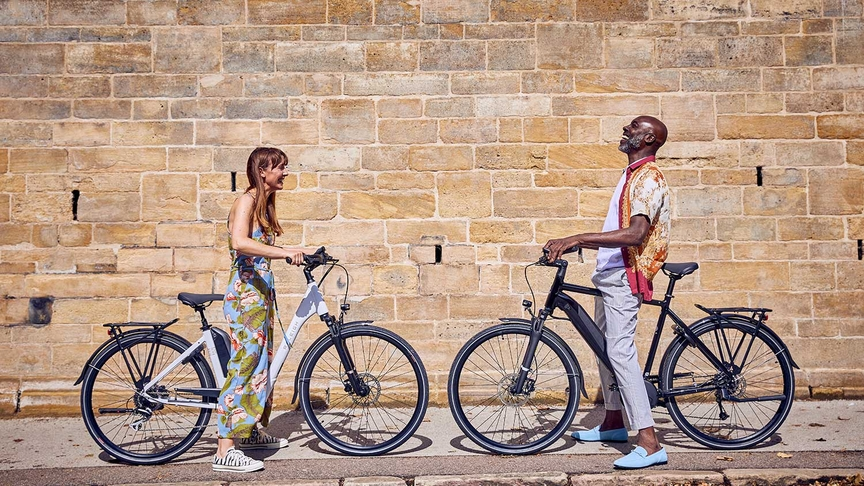 A couple with the Raleigh Motus and Centros ebikes