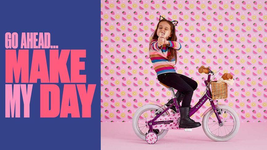 Girl on a Raleigh Molli Kids Bike