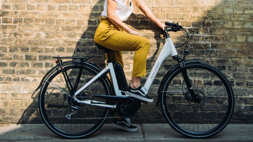 Woman sitting still on a motus ebike