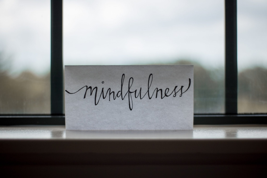 Paper with mindfulness written on it