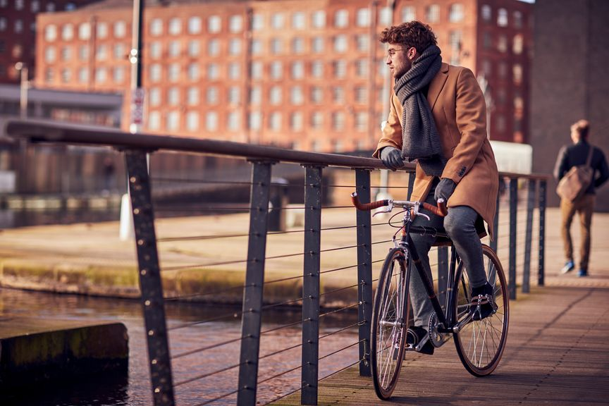 Man resting on a bike
