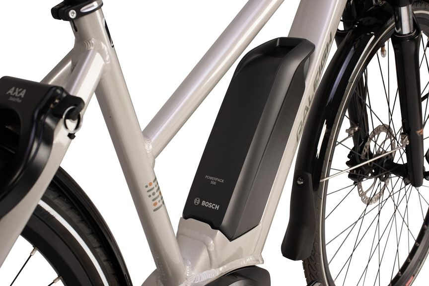 Close up picture of a battery mounted on an eBike's frame.