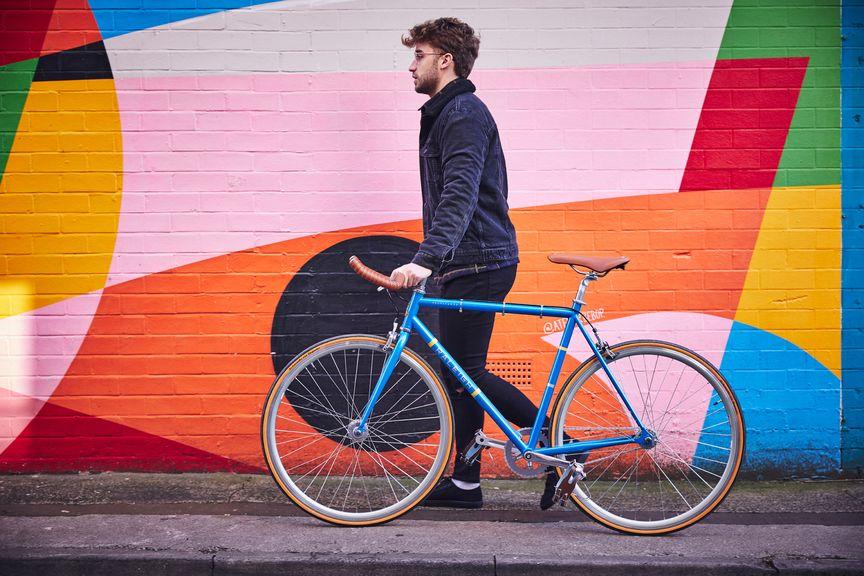 Man walking with his bike next to him