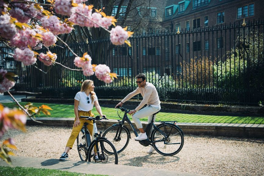 Man and Woman sitting on bikes talking