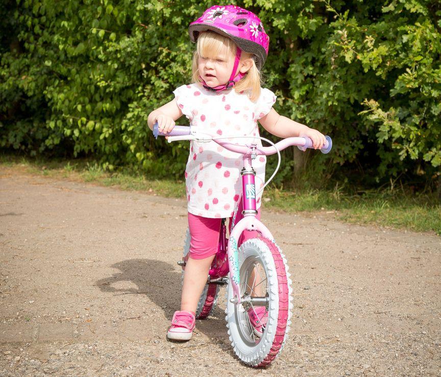 Girl with balance bike