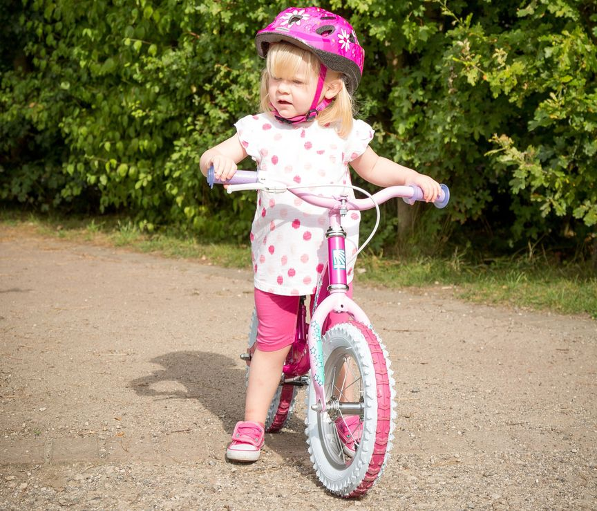 Girl with balance bike